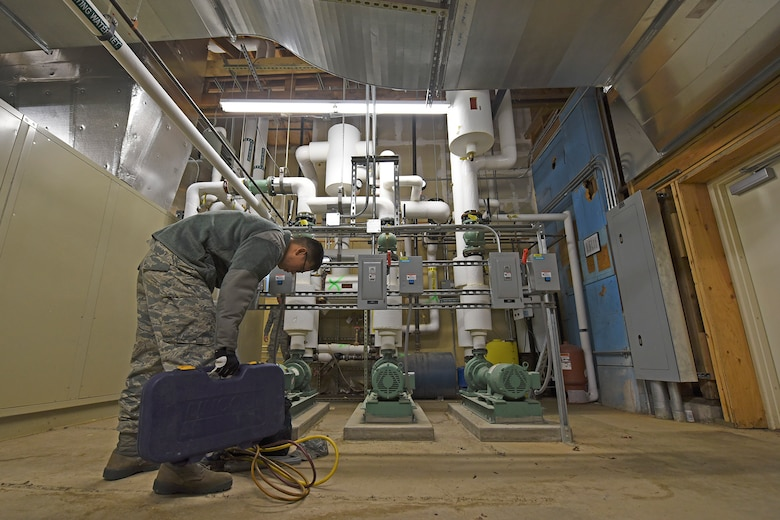 Airman 1st Class Ricky Quan, 92nd Civil Engineer Squadron heating, ventilation, air conditioning and refrigeration technician, completes work on an air conditioning unit in the Red Morgan Center Mar. 2, 2017, at Fairchild Air Force Base, Washington. Maintaining an air conditioning unit involves greasing moving parts and replacing mechanical belts. (U.S. Air Force photo/Senior Airman Mackenzie Richardson)