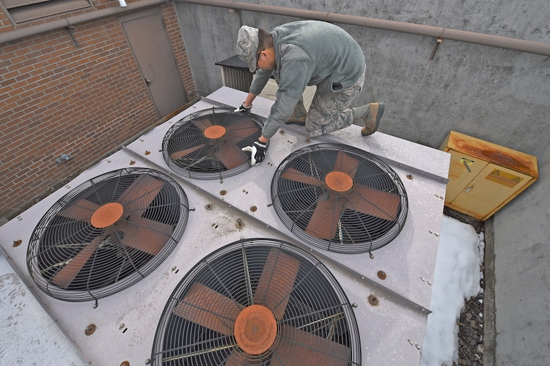 Airman 1st Class Ricky Quan, 92nd Civil Engineer Squadron heating, ventilation, air conditioning and refrigeration technician, ensures an air conditioning unit near the 336th Training Group headquarters is functional Mar. 2, 2017, at Fairchild Air Force Base, Washington. The HVAC/R shop maintains the heating and cooling systems for every building on base. (U.S. Air Force photo/Senior Airman Mackenzie Richardson)
