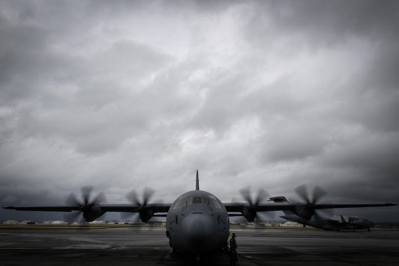 A loadmaster with the 36th Airlift Squadron performs a pre-flight inspection at Kadena Air Base, Japan, March 6, 2017. This is the first C-130J to be assigned to Pacific Air Forces. Yokota serves as the primary Western Pacific airlift hub for U.S. Air Force peacetime and contingency operations. Missions include tactical air land, airdrop, aeromedical evacuation, special operations and distinguished visitor airlift. (U.S. Air Force photo by Staff Sgt. Michael Smith)