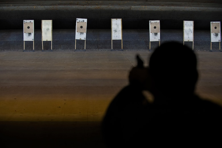Master Sgt. Dennis Henry, 27th Special Operations Wing Public Affairs superintendent, fires his weapon at a target while competing in the Pistol Excellence in Competition March 2, 2017, at Cannon Air Force Base, N.M. Competitors shot a total of 30 rounds at a target 25 yards away during three different timed rounds. (U.S. Air Force photo by Senior Airman Luke Kitterman/Released)