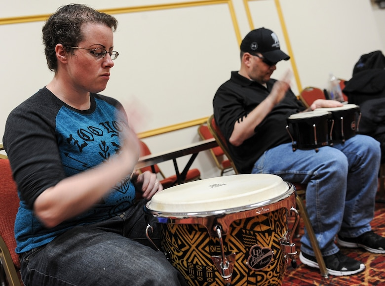 Air Force Wounded Warrior Trials participants play the drums during a Rock to Recovery practice session in Las Vegas, March 1, 2015. One slight deviation to the Rock to Recovery program unique to the AFW2 Trials is the band's live performance at the games' post-event banquet. (U.S. Air Force photo by Staff Sgt. Siuta B. Ika)