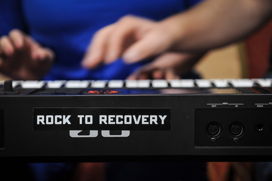 Air Force Wounded Warrior Trials participants play the keyboard during a Rock to Recovery practice session in Las Vegas, March 1, 2015. Geer founded Rock to Recovery in 2012 and took the program to rehab centers, mental health clinics and facilities for at-risk youth, before taking the program to the AFW2 Trials in 2015. (U.S. Air Force photo by Staff Sgt. Siuta B. Ika)