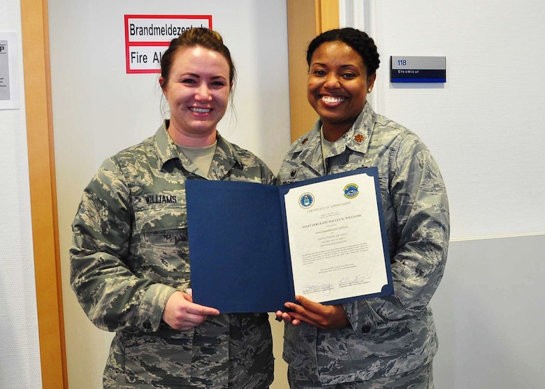 Senior Airman Hayley Williams, 944th Force Support Squadron journeyman, receives her promotion certificate from Maj. Melissa Greene, 944 FSS commander, Feb 28 during her annual tour at Ramstein Air Base, Germany. ( U.S. Air Force photo by Maj. Elizabeth Magnusson)
