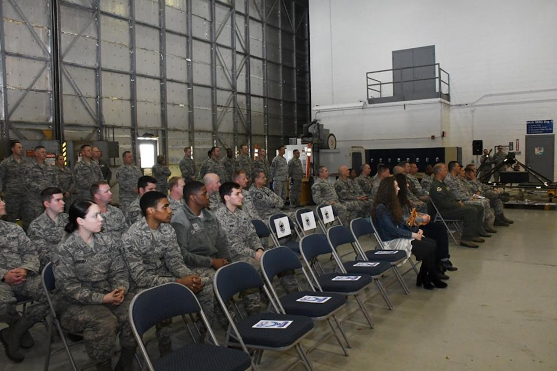 The attendees of Chief Master Sgt. Glen F. Saunders Jr., quality assurance superintendent with the 94th Maintenance Group promotion ceremony. They listen intently as Saunders gives remarks to civilian and military members March, 5, 2017 at Dobbins Air Reserve Base, Georgia. (U.S. Air Force photo/Airman 1st Class Justin Clayvon)