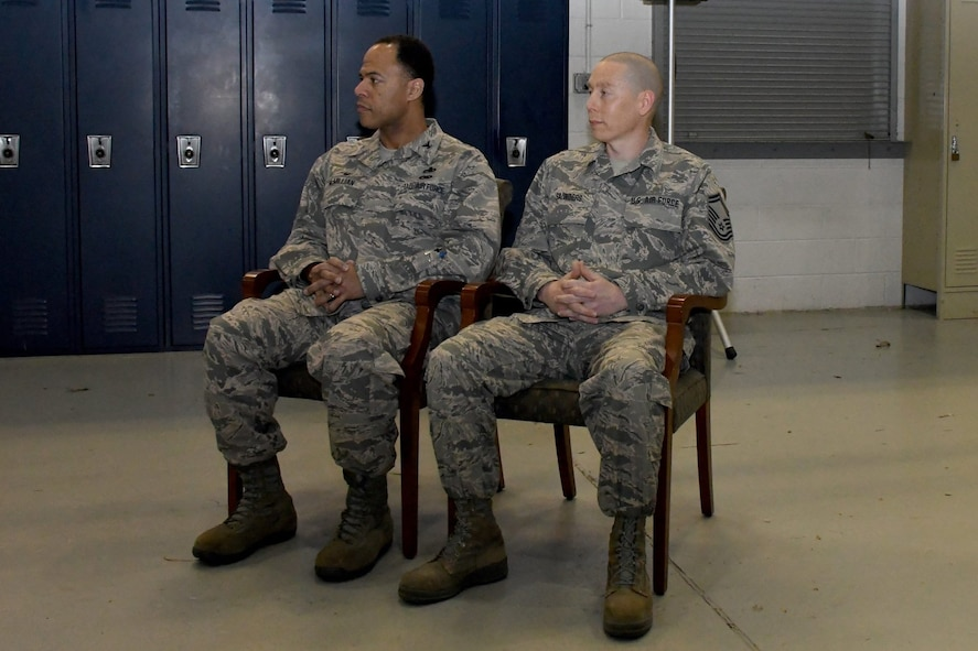 Col. André A. McMillian, commander of the 94th Maintenance Group, and Chief Master Sgt.  Glen F. Saunders Jr., quality assurance superintendent with the 94th MG, listen to remarks during Saunders' promotion ceremony March, 5, 2017 at Dobbins Air Reserve Base, Georgia. (U.S. Air Force photo/Airman 1st Class Justin Clayvon)