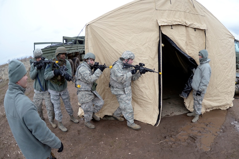 Airmen of the 729th Air Control Squadron practice room clearing procedures during an expeditionary training exercise at Hill Air Force Base's 'North 40' training area. (U.S. Air Force photo by Todd Cromar)