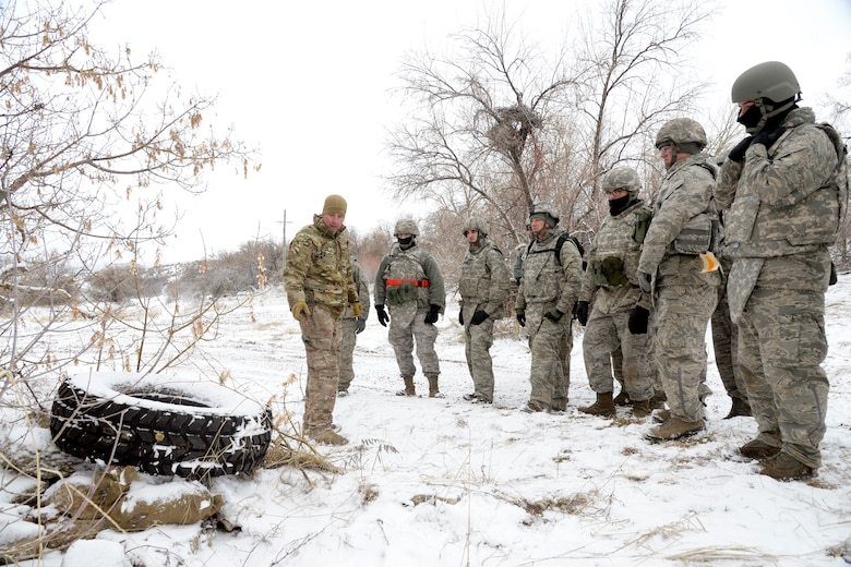 Staff Sgt. Jonathan Woods, 775th Civil Engineer Squadron, briefs 729th Air Control Squadron Airmen on Improvised Explosive Devices, or IEDs, during an expeditionary training exercise at the 'North 40' training area at Hill Air Force Base, Feb. 23. (U.S. Air Force photo by Todd Cromar)