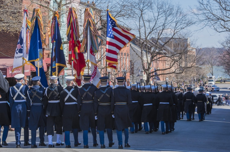 An honor guard composed of members from the Air Force, Army, Coast Guard, Navy and Marines marches in the 2017 Saint Patrick's Day Parade in Alexandria, Va., March 4, 2017. In addition to participating in community events like parades, the ceremonial honor guard flights perform an average of 10 ceremonies each day to represent Airmen to the American public and the world. (U.S. Air Force photo by Senior Airman Jordyn Fetter)
