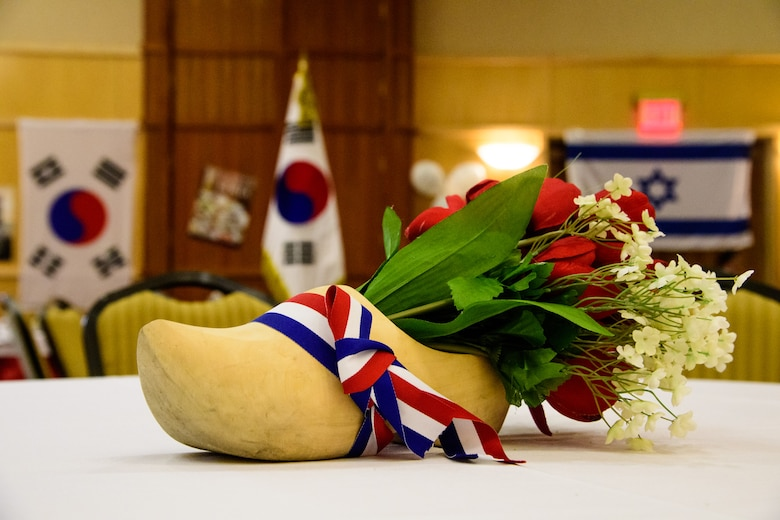 A Dutch wooden shoe wrapped in the colors of the flag of the Netherlands serves as a table centerpiece during the International Buffet at Hill Air Force Base, Utah, March 1, 2017. The annual event offered guests food from 12 countries. (U.S. Air Force photo/R. Nial Bradshaw)