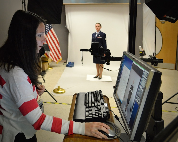 Staff Sgt. Tichina Myers, 377th Aerospace Medicine Squadron, works with base photographer Jamie Burnett on an official photo. Service members who are in need of an official photo should be prepared before contacting multimedia.