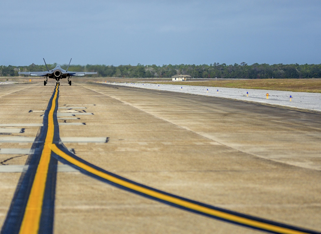 An F-35C Lightning II taxis down the flight line Feb. 27 from the Strike Fighter Squadron 101 at Eglin Air Force Base, Fla. The F-35C variant is a carrier-capable low-observable multi-role fighter aircraft, designed to provide unmatched airborne power projection from the sea. The Navy's joint strike fighter bears structural modifications from other variants, necessitated by the increased resiliency required for carrier operations. (U.S. Air Force photo/Kristin Stewart)