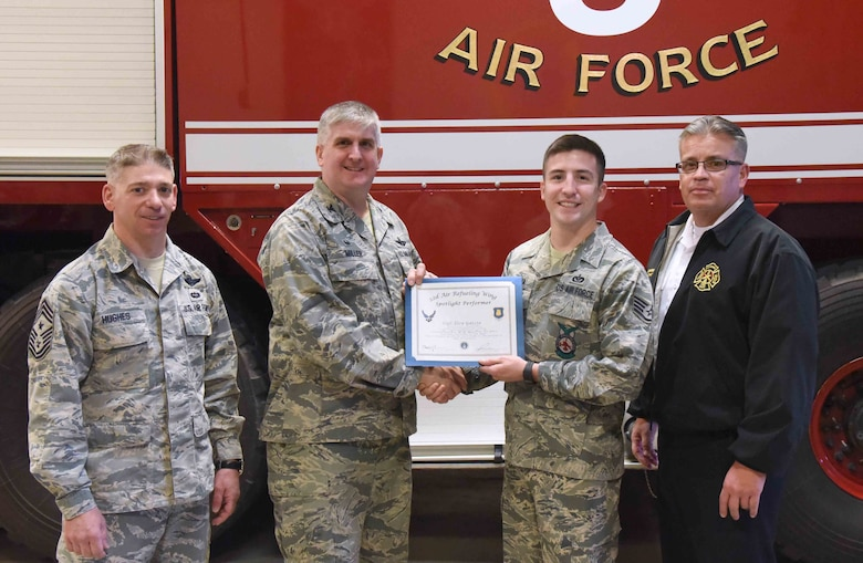 Staff Sgt. Eloy Garcia, 22nd Civil Engineer Squadron fire inspector, poses with 22nd Air Refueling Wing leadership, Feb. 1, 2017, at McConnell Air Force Base, Kan. Garcia received the spotlight performer for the week of Jan 2-6. (U.S. Air Force photo/Airman 1st Class Erin McClellan)