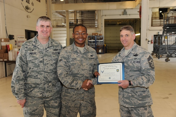 Airman 1st Class Franklin Bonam, 22nd Maintenance Squadron aerospace ground equipment apprentice, poses with Col. Albert Miller, 22nd Air Refueling Wing commander, and Chief Master Sgt. Shawn Hughes, 22nd ARW command chief, Feb. 23, 2017, at McConnell Air Force Base, Kan. Bonam received the spotlight performer for the week of Jan. 23-27. (U.S. Air Force photo/Airman 1st Class Jenna K. Caldwell)