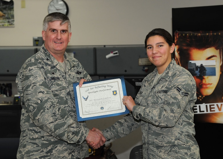 Airman 1st Class Meredith Lindsay, 22nd Medical Support Squadron medical logistics technician, poses with Col. Albert Miller, 22nd Air Refueling Wing commander, Feb. 23, 2017, at McConnell Air Force Base, Kan. Lindsay received the spotlight performer for the week of Feb. 6-10. (U.S. Air Force photo/Airman 1st Class Jenna K. Caldwell)