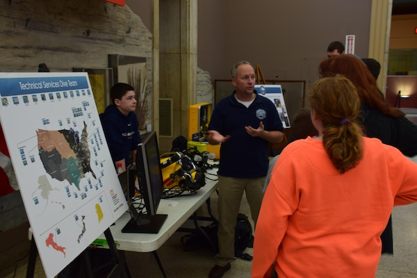 Diver Shanon Chader talks about the Buffalo District Dive Team with some visitors at the Buffalo Museum of Science.