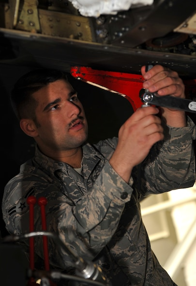 Airman 1st Class Garrett Busler, 9th Maintenance Squadron aircraft fuels systems technician, removes a bolt on U-2 Dragon Lady before they begin the defueling process March 1, 2017, at Beale Air Force Base, California. Aircraft fuels systems technicians perform scheduled and unscheduled maintenance on fuel components. (U.S. Air Force photo/Airman Tristan D. Viglianco)