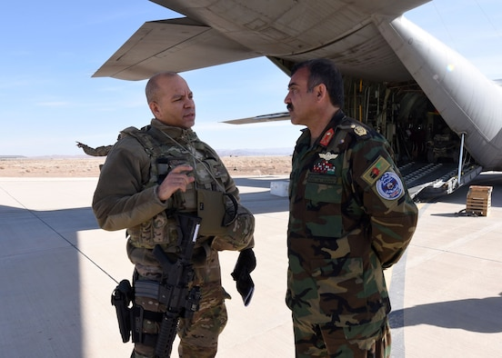 Lt. Col. Jose Lasso, Train, Advise, Assist Command-Air (TAAC-Air) deputy director of logistics, was welcomed by Afghan Air Force Brig. Gen. Abdul Qudratullah, Shindand Air Wing commander, at Herat, Afghanistan, March 1, 2017. The meeting was an opportunity for TAAC-Air advisors in various career fields from logistics, maintenance, safety, intelligence, civil engineer and C-130 flight crews to meet with their counterparts to train and advise, as well as assess the current mission. (U.S. Air Force photo by Tech. Sgt. Veronica Pierce)