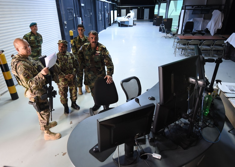 Lt. Col. Jose Lasso, Train, Advise, Assist Command-Air (TAAC-Air) deputy director of logistics, receives a tour of a flight simulator training facility from Afghan Air Force Brig. Gen. Abdul Qudratullah, Shindand Air Wing commander, at Herat, Afghanistan, March 1, 2017. This visit was an opportunity for advisors to have face-to-face interaction with their AAF counterparts. TAAC-Air headquarters is based out of Kabul, Afghanistan. (U.S. Air Force photo by Tech. Sgt. Veronica Pierce)