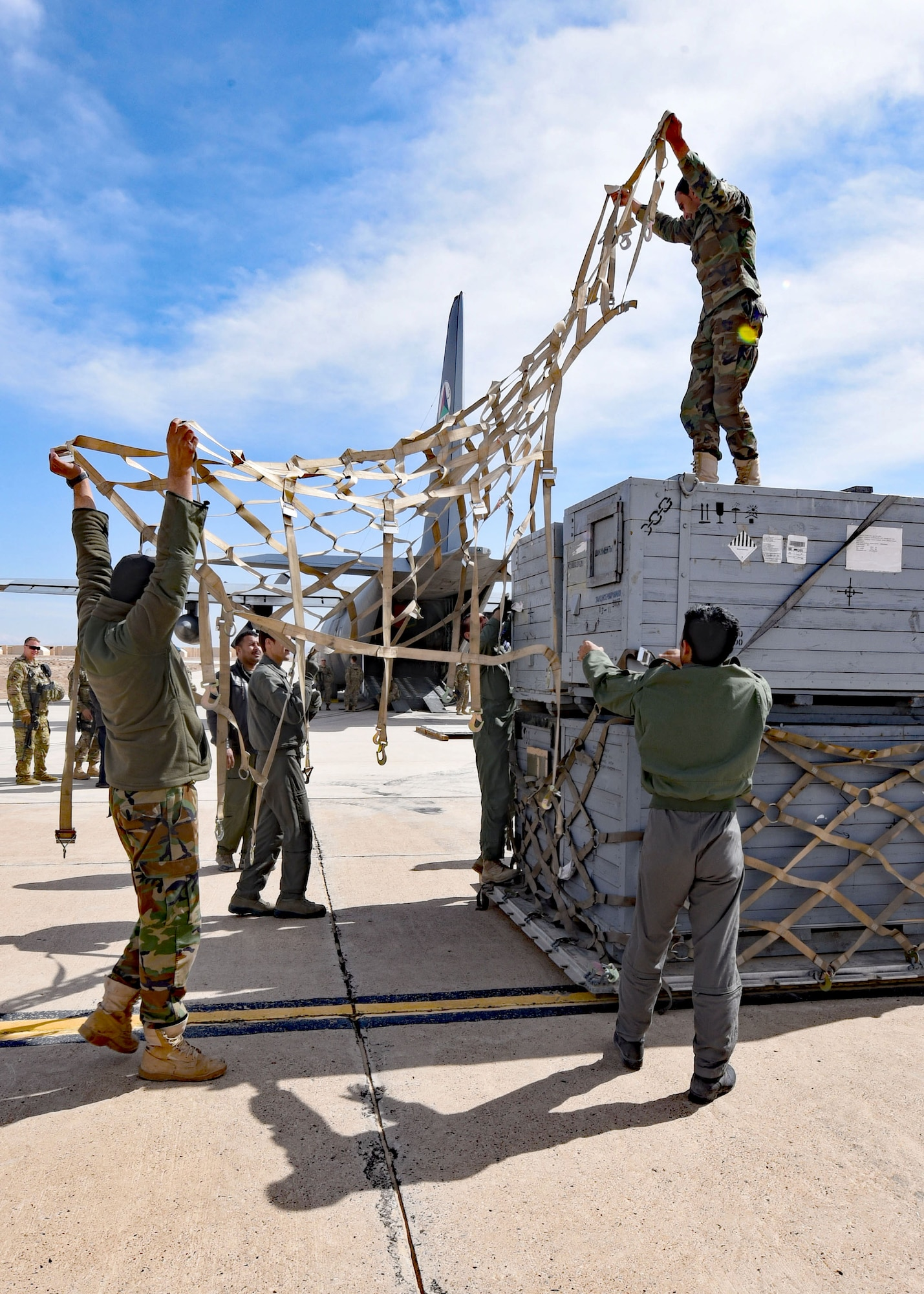 Afghan Air Force C-130H aircrew and maintainers palletize cargo at Shindand Air Wing, Herat, Afghanistan, for transportation to Kabul Air Wing, March 1, 2017. The cargo consisted of 9,000 pounds of Mi-17 parts to be reused for maintenance overhaul. (U.S. Air Force photo by Tech. Sgt. Veronica Pierce)