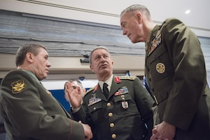 Marine Corps Gen. Joe Dunford, right, chairman of the Joint Chiefs of Staff, speaks with Gen. Hulusi Akar of the Turkish army, center, and Gen. Valery Gerasimov of the Russian army in Antalya, Turkey, March 6, 2017. The three chiefs of defense are discussing their nations' operations in northern Syria. DoD photo by Navy Petty Officer 2nd Class Dominique Pineiro
