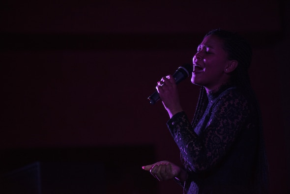 Senior Airman Erika Fajardo sings during the Aviano's Got Talent finale, March 2, 2017, at Aviano Air Base, Italy. Fajardo was crowned the winner and received the $1,000 grand prize. (U.S. Air Force photo by Senior Airman Cory W. Bush)
