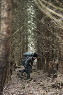 A U.S. Air Force pilot assigned to the 480th Fighter Squadron walks through a wooded area during Survival, Evasion, Resistance and Escape training near Spangdahlem Air Base, Germany, March 3, 2017. SERE was established by the U.S. Air Force at the end of World War II and was extended and consolidated during the Vietnam War to the U.S. Marine Corps, U.S. Navy and in the late 1980s to the U.S. Army. (U.S. Air Force photo by Airman 1st Class Preston Cherry)