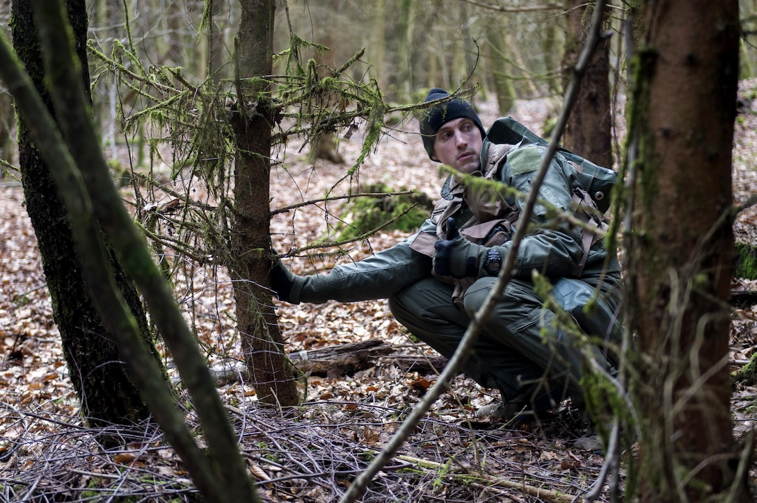 A U.S. Air Force pilot assigned to the 480th Fighter Squadron puts a thumb up signaling it's clear to proceed during Survival, Evasion, Resistance and Escape training near Spangdahlem Air Base, Germany, March 3, 2017. The training was a SERE refresher course and is required of all aircrew personnel. (U.S. Air Force photo by Airman 1st Class Preston Cherry)