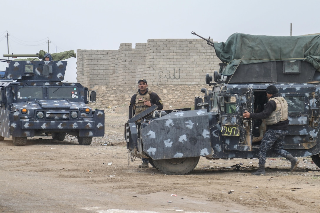 Iraqi federal police mount vehicles for a movement near West Mosul, Iraq, March 2, 2017. The breadth and diversity of partners supporting the Coalition demonstrate the global and unified nature of the endeavor to defeat ISIS. Combined Joint Task Force-Operation Inherent Resolve is the global Coalition to defeat ISIS in Iraq and Syria. (U.S. Army photo by Staff Sgt. Jason Hull)