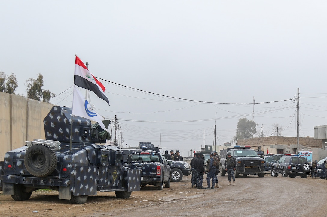 Iraqi federal police prepare for another day's offensive to liberate and secure West Mosul, Iraq, March 2, 2017. The breadth and diversity of partners supporting the Coalition demonstrate the global and unified nature of the endeavor to defeat ISIS. Combined Joint Task Force-Operation Inherent Resolve is the global Coalition to defeat ISIS in Iraq and Syria. (U.S. Army photo by Staff Sgt. Jason Hull)