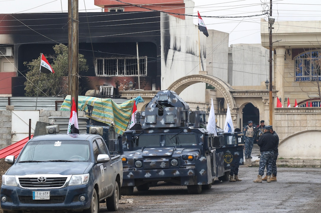 Iraqi federal police occupy a street within the city during the offensive to liberate and secure West Mosul, Iraq, March 2, 2017. The breadth and diversity of partners supporting the Coalition demonstrate the global and unified nature of the endeavor to defeat ISIS. Combined Joint Task Force-Operation Inherent Resolve is the global Coalition to defeat ISIS in Iraq and Syria. (U.S. Army photo by Staff Sgt. Jason Hull)