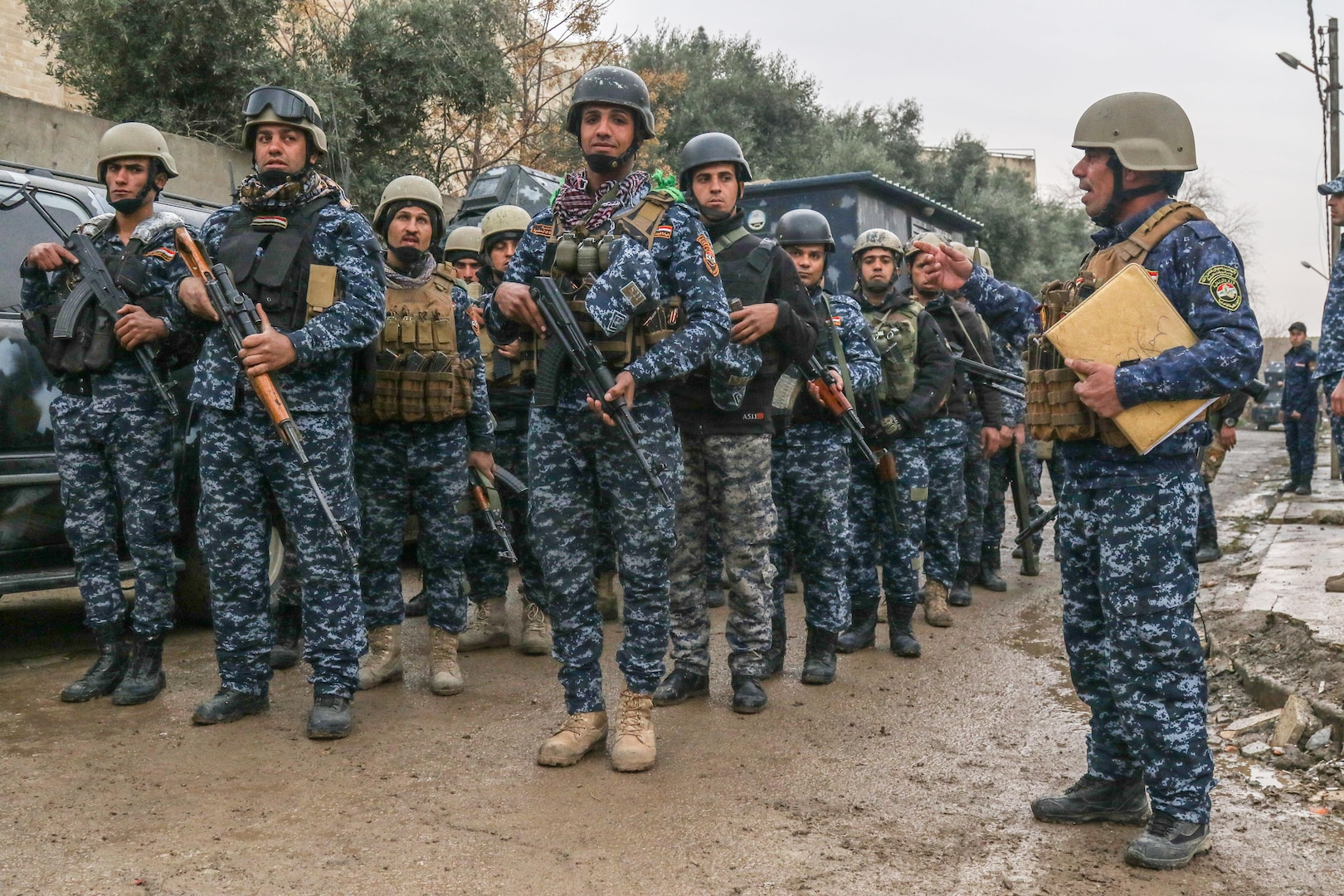Iraqi federal police stand in formation in West Mosul, Iraq, March 2, 2017. The breadth and diversity of partners supporting the Coalition demonstrate the global and unified nature of the endeavor to defeat ISIS. Combined Joint Task Force-Operation Inherent Resolve is the global Coalition to defeat ISIS in Iraq and Syria. (U.S. Army photo by Staff Sgt. Jason Hull)