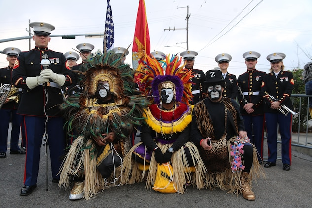 Members of the Zulu Social Aid and Pleasure Club take a photo with the 2nd Marine Aircraft Wing Band during Mardi Gras festivities in New Orleans, Feb. 28, 2017. The 2nd MAW band provided music and was a face of the Marine Corps during the parade. The Zulu Social Aid and Pleasure Club contributes to the local community in numerous different ways including providing Christmas baskets to needy families and donating funds and time to other community organizations. (U.S. Marine Corps photo by Lance Cpl. Cody Lemons/Released)