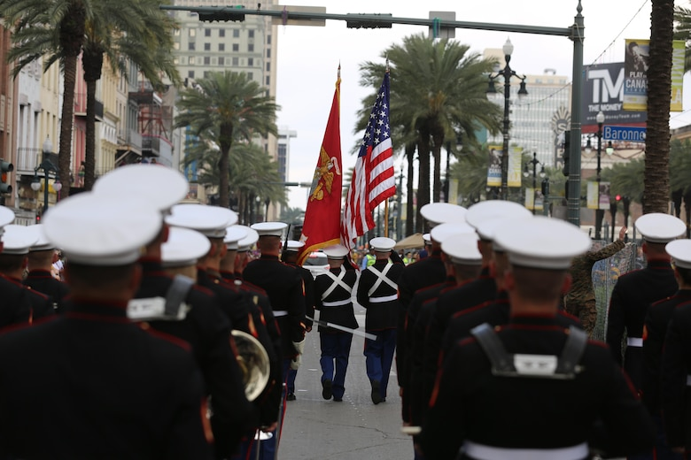 The 2nd Marine Aircraft Wing Band marches down the street during a Mardi Gras parade in New Orleans, Feb. 28, 2017. The band was led by drum major Sgt. Nathan Johnson, and played traditional jazz music and the Marines' Hymn during the parade. The band followed the color guard that carried the American and Marine Corps flags. (U.S. Marine Corps photo by Lance Cpl. Cody Lemons/Released)