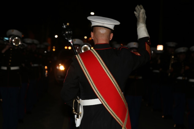 "Gunnery Sgt. Aaron Goldin leads the 2nd Marine Aircraft Wing Band from his position as the drum major at a night parade during Mardi Gras festivities in New Orleans, Feb. 24, 2017. The band provided support to Marine Corps Band New Orleans during Mardi Gras by playing in parades it could not attend. The 2nd MAW Band played traditional Mardi Gras tunes such as ""Bourbon Street"" and ""Rampart Street Parade."" (U.S. Marine Corps photo by Lance Cpl. Cody Lemons/Released)"