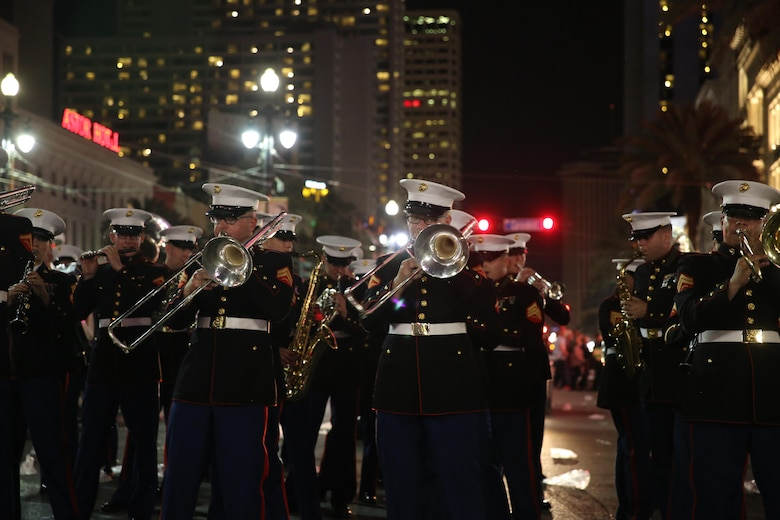 "The 2nd Marine Aircraft Wing Band plays under bright-city lights for a crowd in a parade during the Mardi Gras celebrations in New Orleans, Feb. 24, 2017. The band traveled from Marine Corps Air Station Cherry Point, N.C., to attend the celebrations and provide music during multiple parades. The band played traditional jazz music such as ""Bourbon Street"" and ""Rampart Street Parade"" during the parades. (U.S. Marine Corps photo by Lance Cpl. Cody Lemons/Released)"