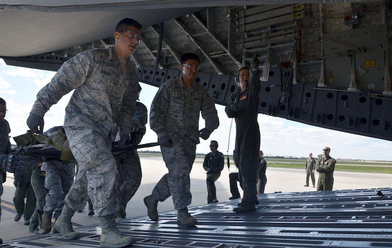 Air Force Reservists Airman Michael Alvarez, left, and Staff Sgt. Roberto Gonzalez, both with the 920th Aeromedical Staging Squadron, load a simulated patient onto a C-17 Globemaster III during the 5th annual MEDBEACH joint medical response exercise March 5, 2017 at Patrick Air Force Base, Florida. The C-17 Globemaster III and an Army National Guard UH-60 Black Hawk were flown in to provide a staging platform for stabilization and transport of battlefield-injured service members. (U.S. Air Force photo/Capt. Leslie Forshaw)