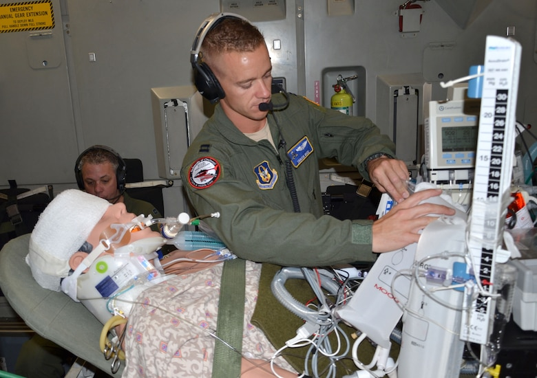 Capt. Travis Bice, 920th Aeromedical Staging Squadron critical care air transport team nurse, stabilizes a simulated patient aboard a C-17 Globemaster III March 5, 2017 as part of the 5th annual MEDBEACH joint medical response exercise at Patrick Air Force Base, Florida. More than 250 military medics from 12 units across the country participated in the week-long exercise. (U.S. Air Force photo/Capt. Leslie Forshaw)
