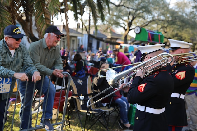 "Marines assigned to the 2nd Marine Aircraft Wing Band play ""Anchors Aweigh"" to former U.S. Navy service members before a parade in New Orleans, Feb. 26, 2017. The 2nd MAW Band attended the Mardi Gras celebrations where they provided music for the spectators during multiple parades. The parades allowed the band to be the face of the Marine Corps while interacting with observers. (U.S. Marine Corps photo by Lance Cpl. Cody Lemons/Released)"