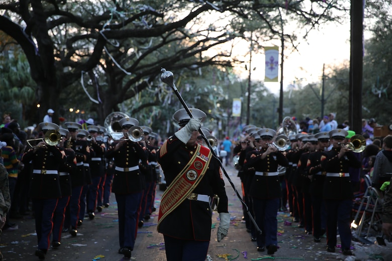 "Gunnery Sgt. Aaron Goldin leads the 2nd Marine Aircraft Wing through a confetti and bead filled street during a parade in New Orleans, Feb. 26, 2017. The band was in multiple parades for the Mardi Gras celebrations and provided music for the spectators. They played classic Mardi Gras songs such as ""Bourbon Street"" and ""Rampart Street Parade."" (U.S. Marine Corps photo by Lance Cpl. Cody Lemons/Released)"