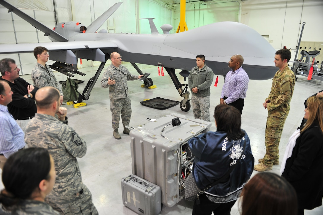 Lt. Col. Michael Thompson, 727th Special Operations Aircraft Maintenance Squadron commander, center, leads an MQ-9 discussion with members of the Civilian Leadership Development Program during their visit Feb. 28, 2017, to Cannon Air Force Base, N.M. The group is comprised of competitively-selected GS-11 to GS-13 civilians from AFSOC Headquarters and got an up-close look at an MQ-9 Reaper during their visit.