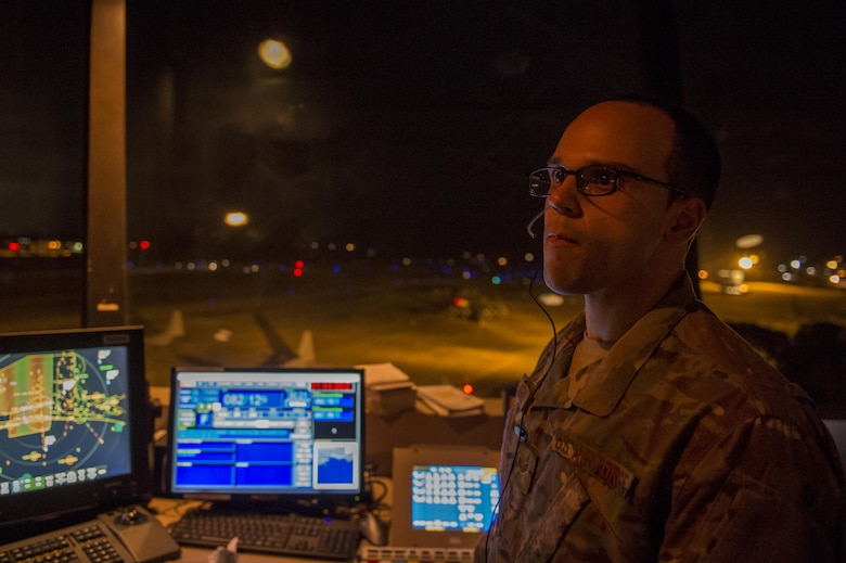 Senior Airman Xavier Rodriguez, an air traffic controller with the 1st Special Operations Support Squadron, watches as aircraft land during Emerald Warrior on Hulburt Field, Fla. Feb, 28, 2017. Emerald Warrior is a U.S. Special Operations Command exercise during which joint special operations forces train to respond to various threats across the spectrum of conflict. (U.S. Air Force photo by Airman 1st Class Sean Carnes)