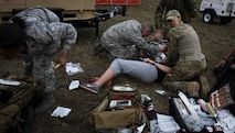 U.S. Air Force members of a Special Operations Forces Medical Element team and En-Route Patient Staging System 10 team respond to a medical emergency during Exercise Emerald Warrior 17 at Hurlburt Field, Fla., Feb. 28, 2017. Emerald Warrior is a U.S. Special Operations Command exercise during which joint special operations forces train to respond to various threats across the spectrum of conflict. (U.S. Air Force photo by Senior Airman Clayton Cupit)