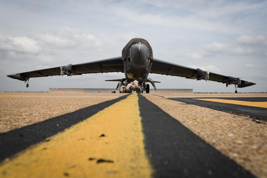 Members of the 2nd Maintenance Squadron wait to tow Aircraft 0049 at Barksdale Air Force Base, La., Feb. 28, 2017. A0049 was part of Operation Allied Force in 1999, meant to ensure an ending to all military action, violence and repression in Kosovo and a withdrawal of Serbian military, police and paramilitary forces. (U.S. Air Force photo/Airman 1st Class Stuart Bright)