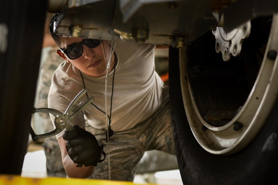Airman 1st Class Cory Cronin, 2nd Maintenance Squadron phase inspection team member, prepares A0049 to be towed to its final resting place at Barksdale Air Force Base, La., Feb. 28, 2017. A0049 was used for testing until a maintenance related accident in 2014 took it out of commission. (U.S. Air Force photo/Airman 1st Class Stuart Bright)