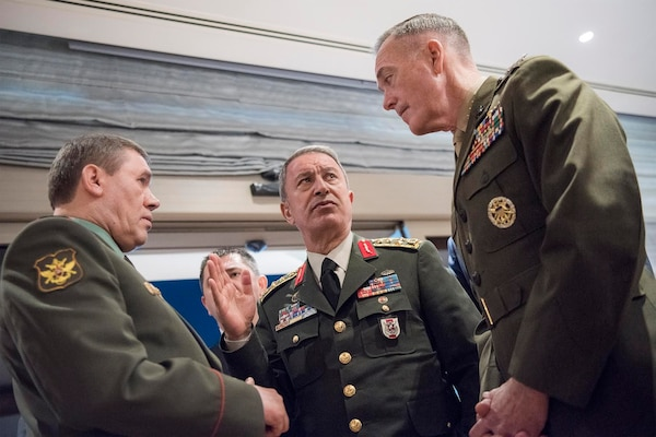 Marine Corps Gen. Joe Dunford, right, chairman of the Joint Chiefs of Staff, speaks with Gen. Hulusi Akar of the Turkish army, center, and Gen. Valery Gerasimov of the Russian army in Antalya, Turkey, March 6, 2017. The three chiefs of defense are discussing their nations' operations in northern Syria.