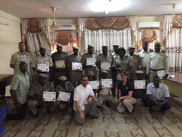 Attendees at the inaugural Law Enforcement Investigative Skills Exchange Program conducted by the Air Force Office of Special Investigations in the West African country of Burkina Faso display their certificates. (U.S. Air Force photo/25 EFIS)