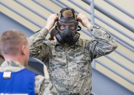A member of the 366th Logistics Readiness Squadron dons his gas mask during an exercise Feb. 28, 2017, at Mountain Home Air Force Base, Idaho. There is a specific order in which their protective gear must be applied to ensure speed and safety. (U.S. Air Force photo by Airman Jeremy D. Wolff/Released)