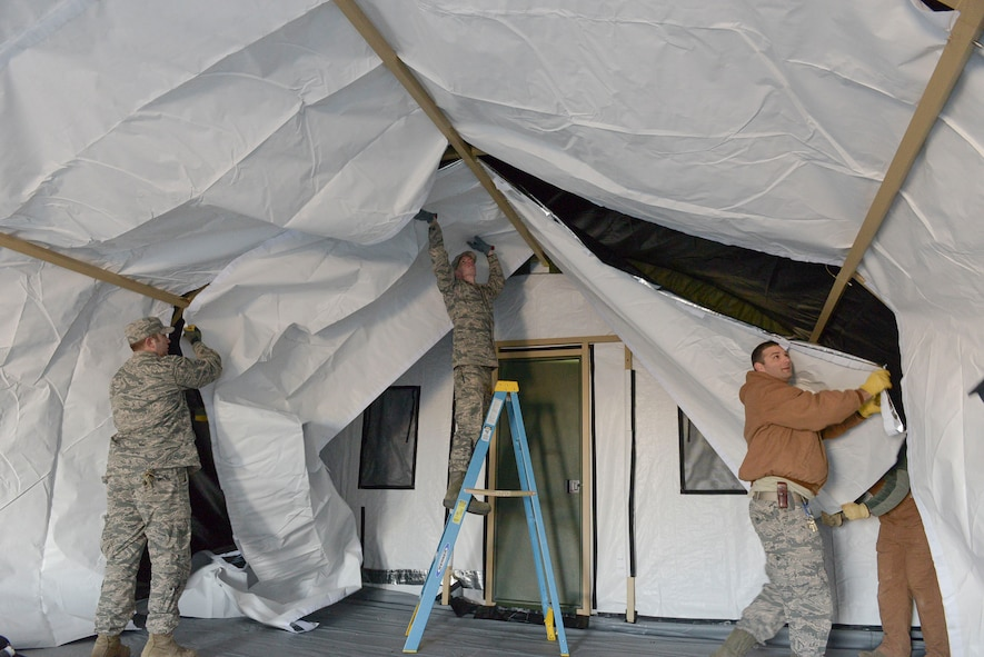 Members of the 366th Civil Engineer Squadron construct a tent during an exercise at Mountain Home Air Force Base, Idaho. The focus of the base wide exercise was mission readiness and took place from Feb. 28 through March 2. (U.S. Air Force photo by Airman Jeremy D. Wolff/Released)