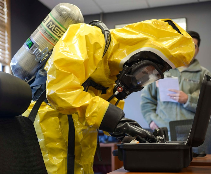 Airmen assigned to the 366th Bio Environmental Flight gear up to enter an area with a simulated chemical threat at Mountain Home Air Force Base, Idaho, March 1st, 2017. The team uses specialized equipment to test the chemical compounds of explosives. (U.S. Air Force photo by Airman Jeremy Wolff)