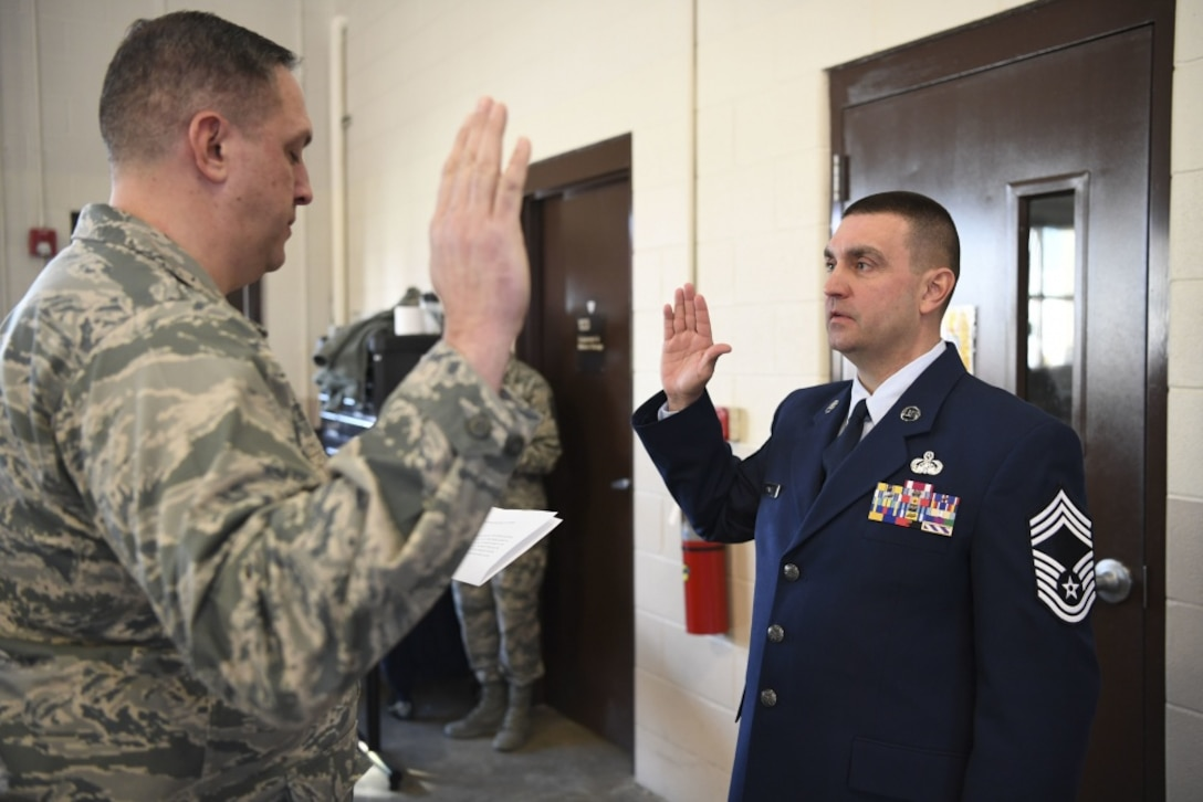 Chief Master Sgt. Mike Powell, 130th Airlift Wing communications flight chief enlisted manager, recites the Chief's Creed during a formal promotion ceremony held March 4, 2017 at McLaughlin Air National Guard Base, Charleston, W.Va. Powell was promoted to the highest enlisted rank in the Air Force after more than 23 years in the West Virginia Air National Guard. (U.S. Air National Guard photo by Tech. Sgt. Eugene Crist)